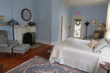 king bed with fireplace and private outside entrance