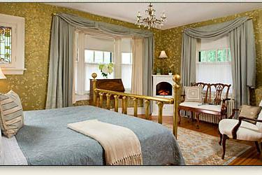 Queen Room king-size brass bed and electric fireplace