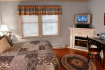 Springfield House Guest Room with fireplace and tv